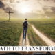 man walking toward the cross with a backpack